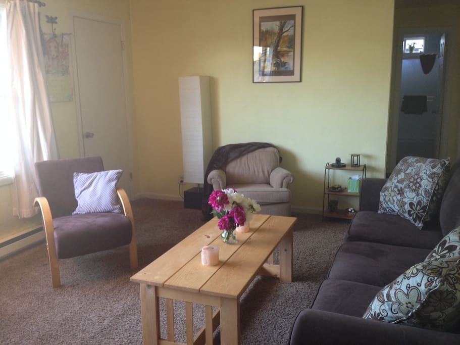 Warm and comfortable living space, easily seats 5 with large windows overlooking the Coburg Hills.