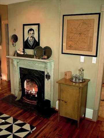 Our simulated coal/propane fueled fireplace adds just the right touch to our vintage building