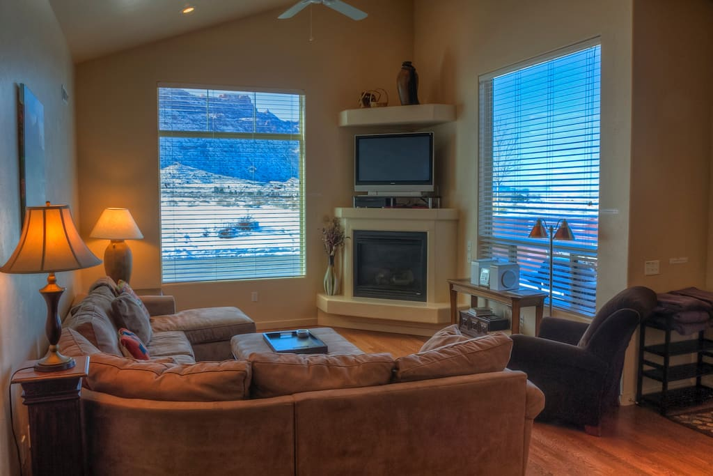 Living room with spectacular Moab Rim views from the couch.