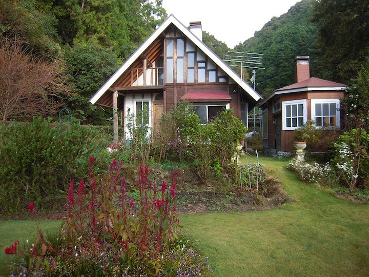 Log guest house with beautiful lawn garden