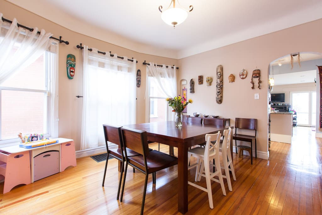 Dining room table with seating for eight, and a kids art table