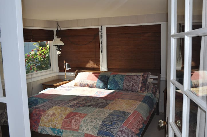 The new king size bed - There are dark blinds on all of the windows for privacy and blocking light
