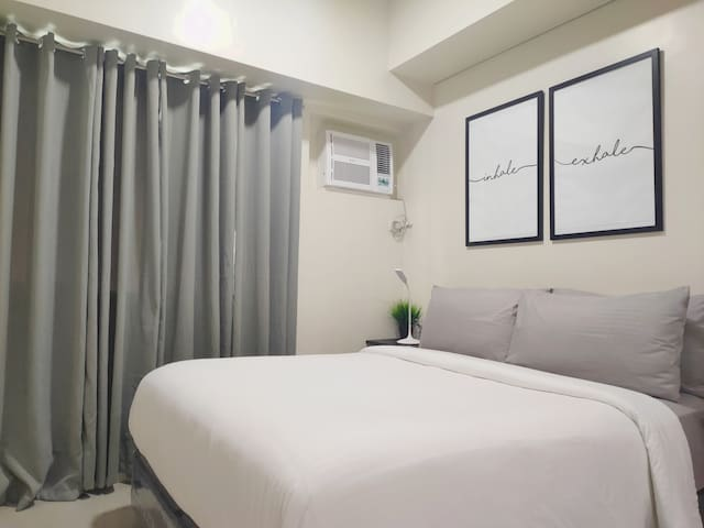"Hotel bed. 50 Mbps wifi. Netflix on 50"" TV. MAKATI"