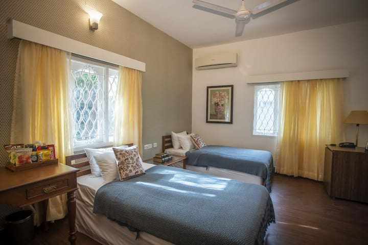 Kamal: A twin-bed room in a beautiful bungalow