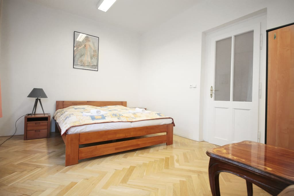 Room #1: double-bed, chairs, wardrobe, table
