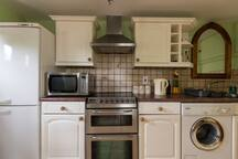 Fully fitted kitchen with modern full size appliances.