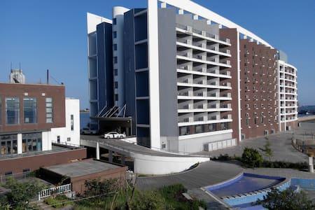 807海阳曦岛游艇会旅游度假一线海景公寓 - Yantai - Appartement