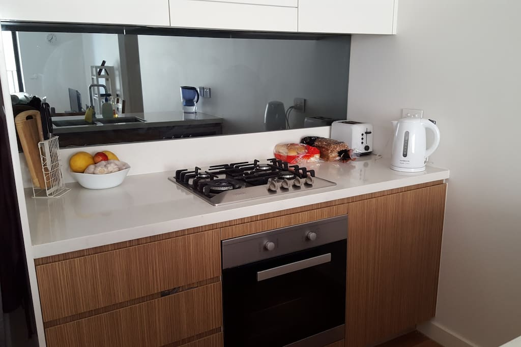 Fully equipped kitchen with gas burner and oven