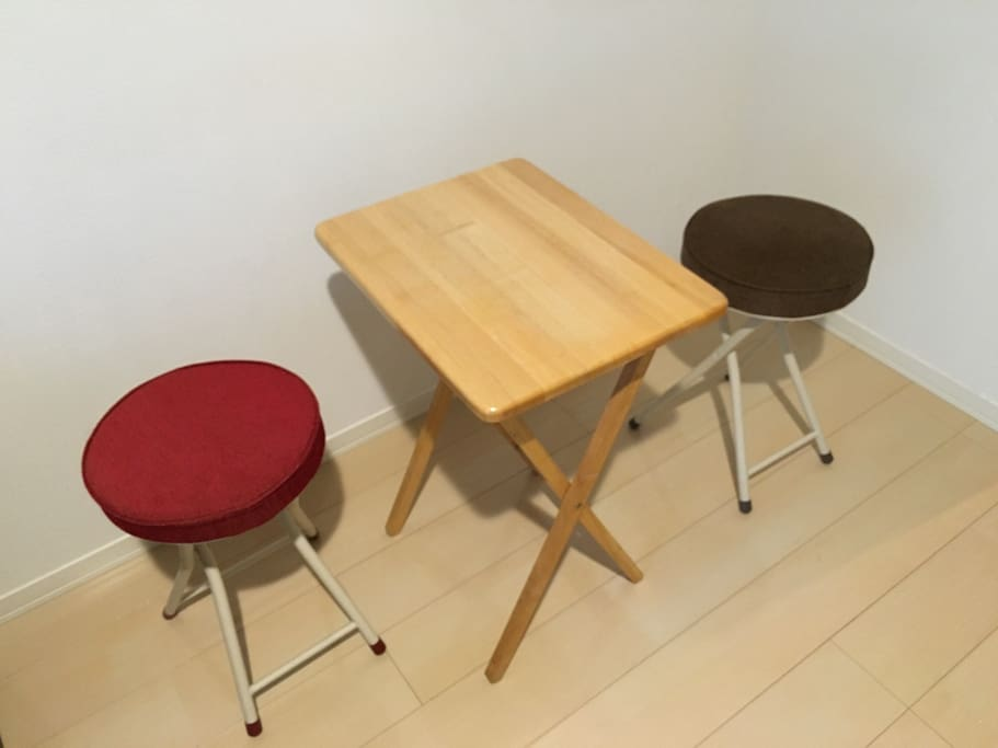 two folding chairs and table for eating , PC, and more ...