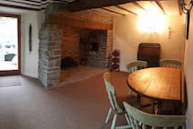 Dining room with entrance door & field view.