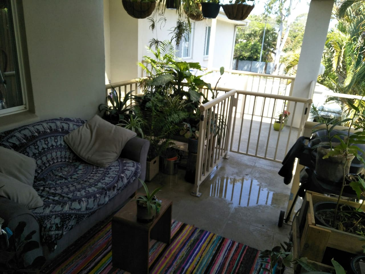 Lovely, green and breezy balcony to enjoy the peace and tranquility of this glorious boho space.
