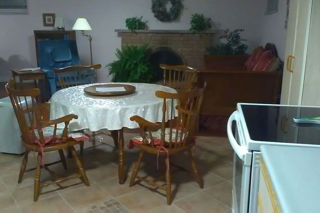 Expandable dining room table situated between the kitchen and the living room.  Trundle bed behind.  Smooth top oven for cooking those delicious meals on the go.