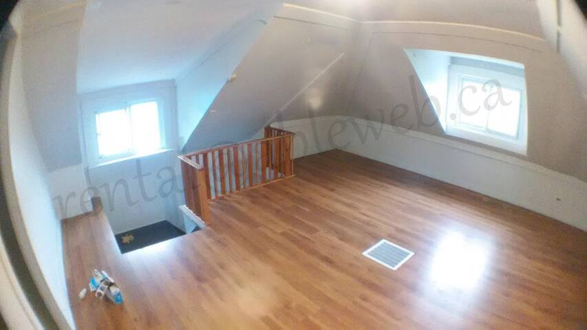 Loft in a small walk up unit in a House
