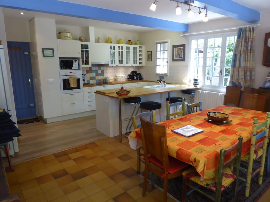 Open plan well equipped kitchen and dining area