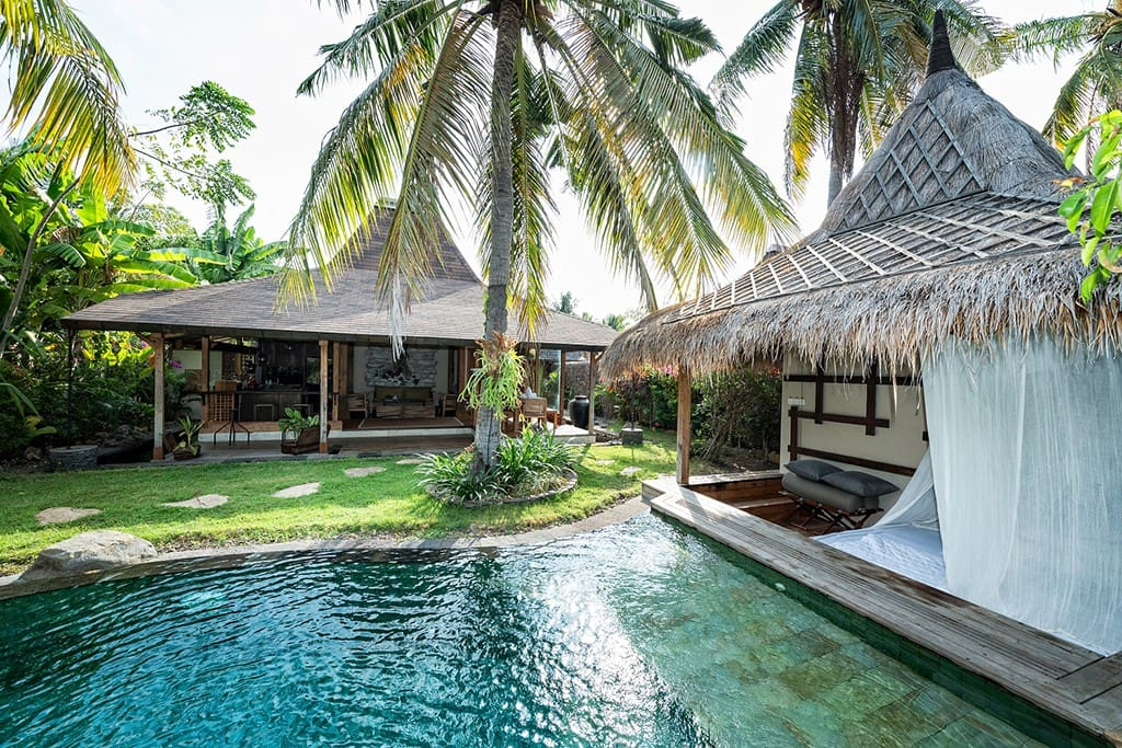 Villa Bhuvana is set on 400m2 tropical garden with coconut palm trees, booming flowers and ferns