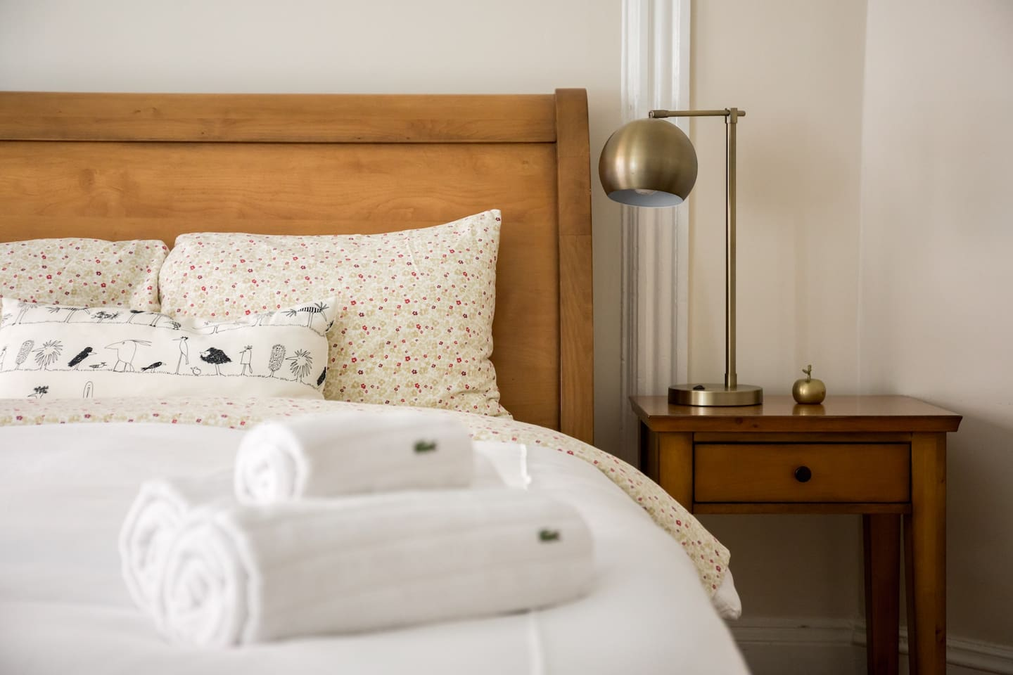 The sleigh bed is covered in a fluffy duvet in fall and winter or a lighter blanket in the warm months.