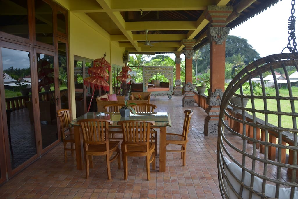 Spacious veranda with seating set, beautiful carved and painted daybed
