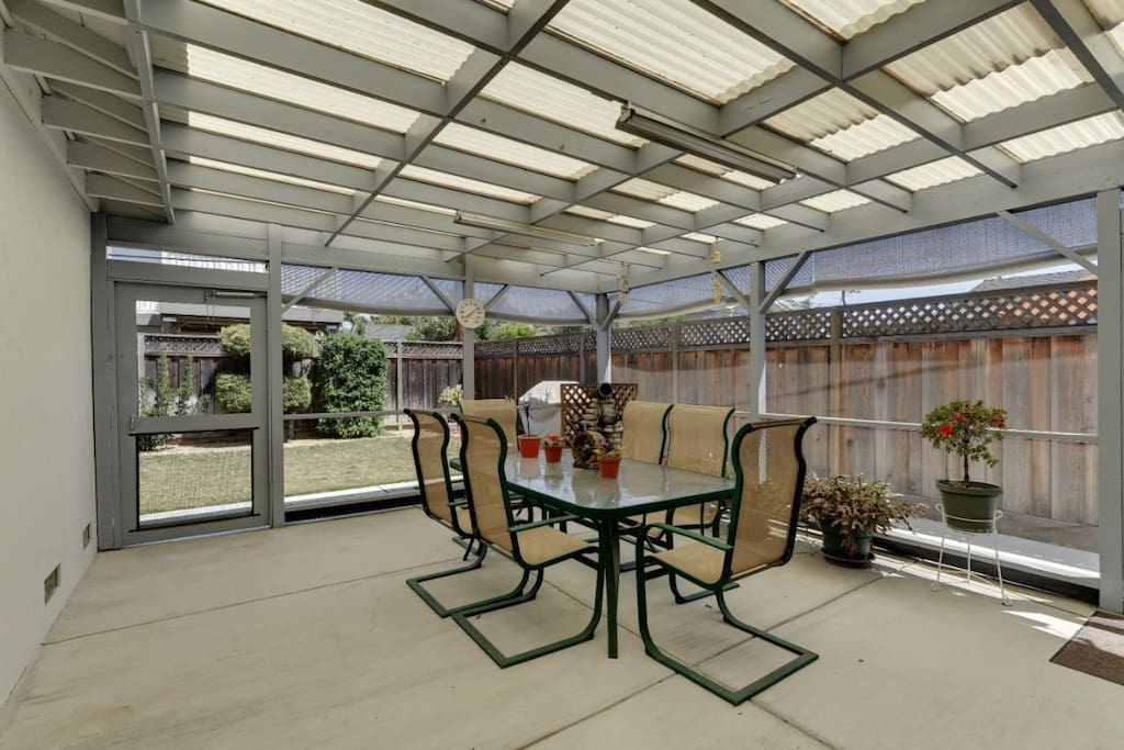 Large covered back patio. Cute potted succulents on perimeter. Geometric cut shrubs. NEW! Rain gutter garden located on right side of patio and two large garden boxes in backyard. You're welcome to garden with us!