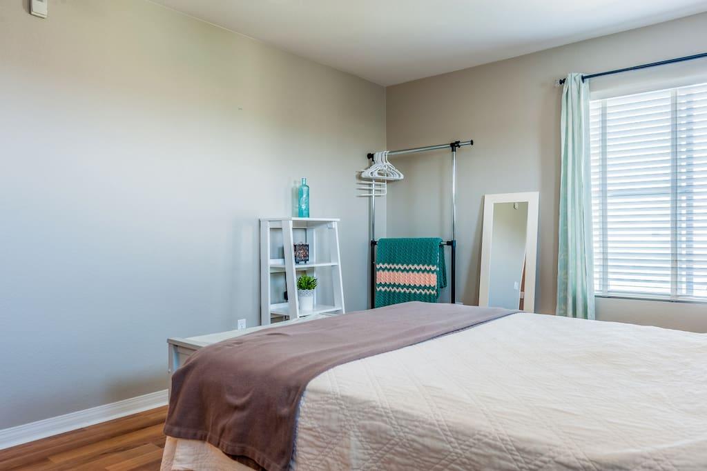 Garment rack & mirror in master bedroom