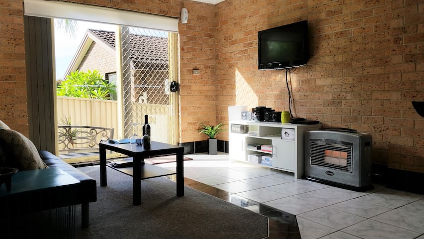 Large living room with comfy couch, gas heating, flat screen HD TV & access to huge DVD library, Nintendo Wii and Platinum Foxtel IQ3 package
