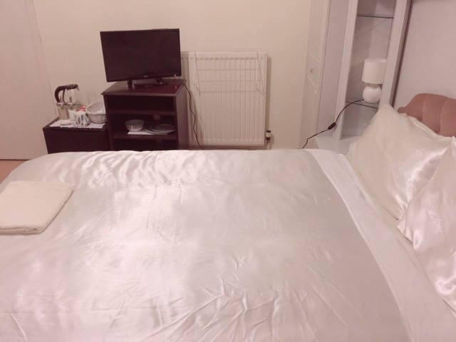 double bed with big and small towel