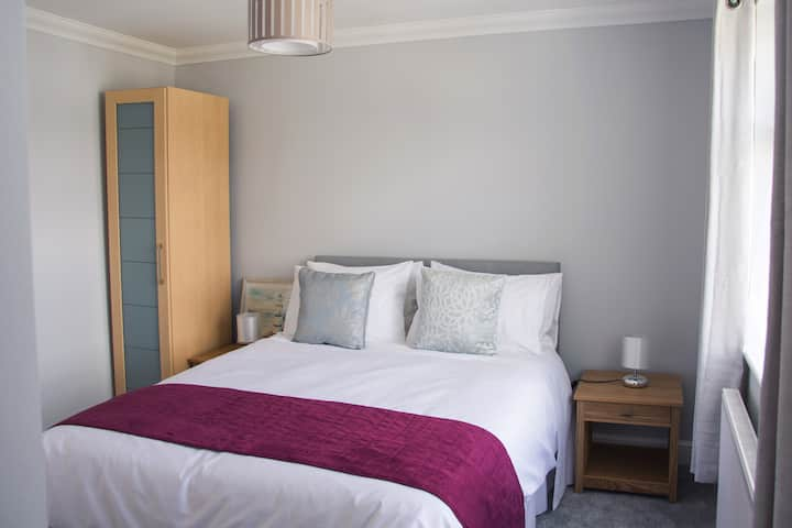 The Cove , a double room with en suite shower.