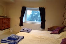 Good sized bedroom with lovely far reaching views from windows.