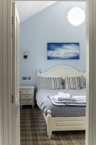 Master bedroom with king-size bed
