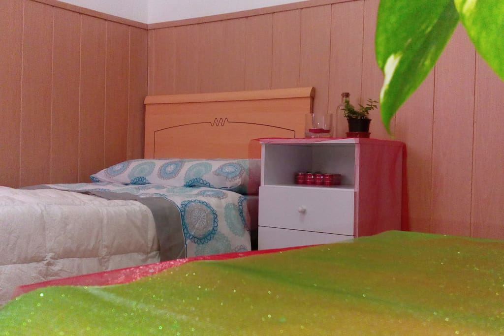 Red room, inspired en Muladhara Chakra. Single bed, night table, closet, little table, soft armchair and love!