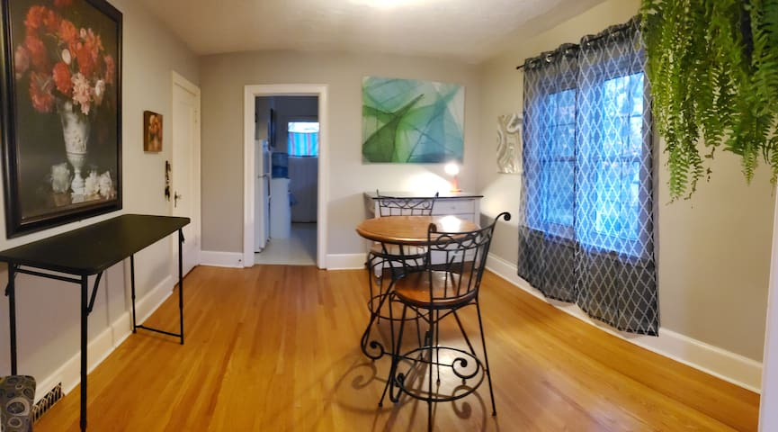 Dining area leading into kitchen