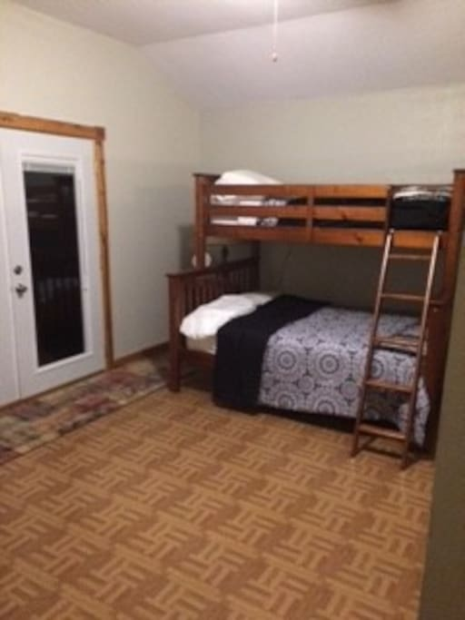 Large french doors allow for easy access to the balcony. Full sized bed on bottom, single on top.