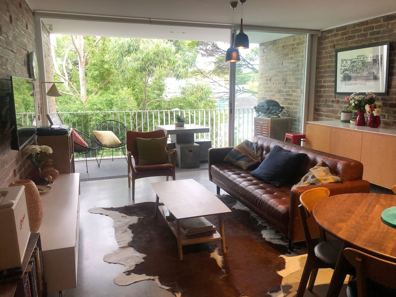 Living/Dining area flows to private covered balcony