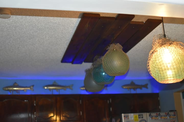 A view of our kitchen lights at night.