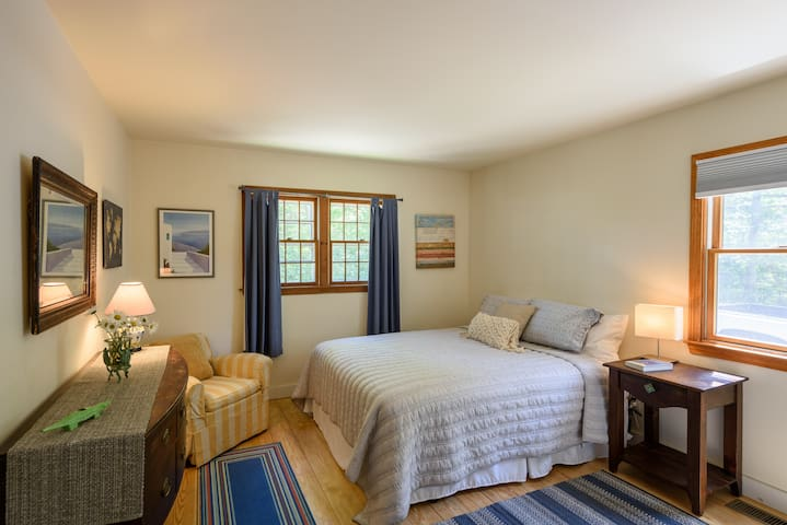 """Bedroom #1. First floor. Queen size bed. Gets lots of natural light. """"The Sunshine Room."""""""