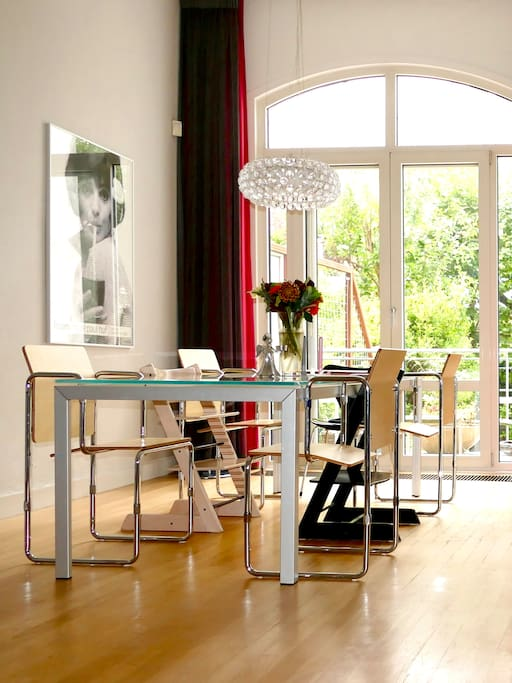 Dining table with chairs of Frits Hansen, Gerrit Rietveld and kids chairs of Stokke, lightened by Cabosche Foscarini