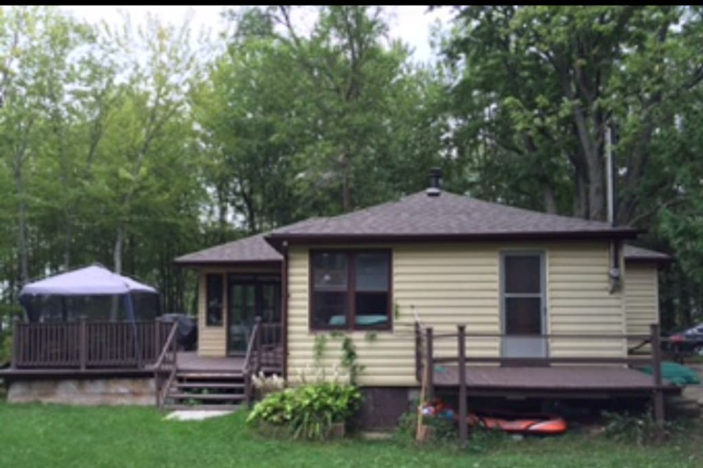 cottage, deck and kitchen tent.