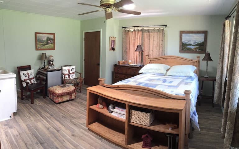 Queen-size bed with fridge