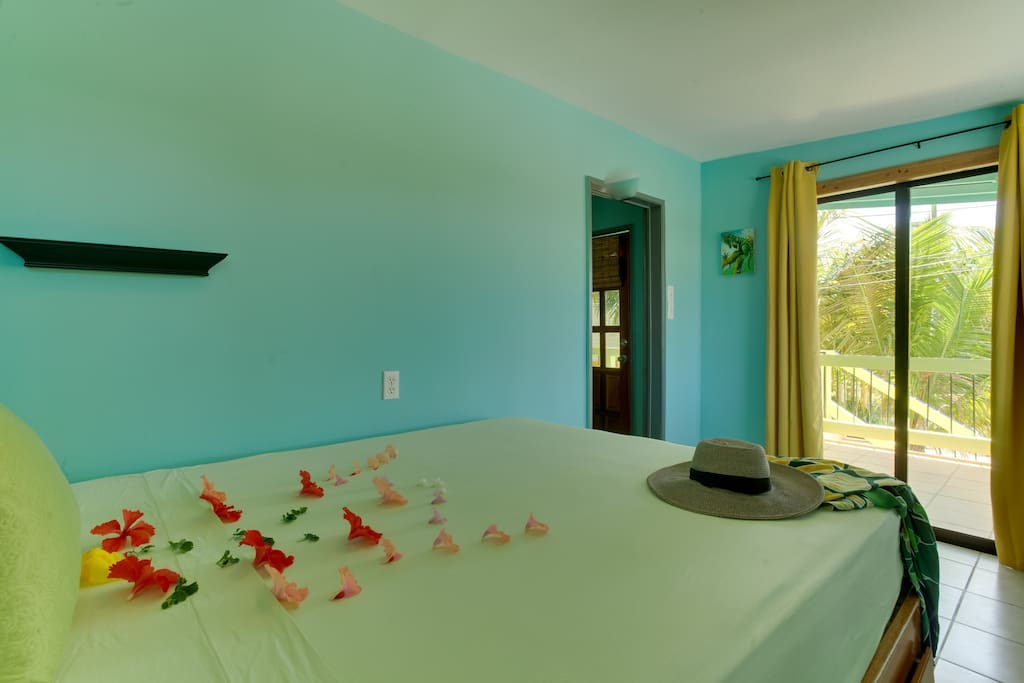 Distant views of cayes on Caribbean sea from your Queen bed