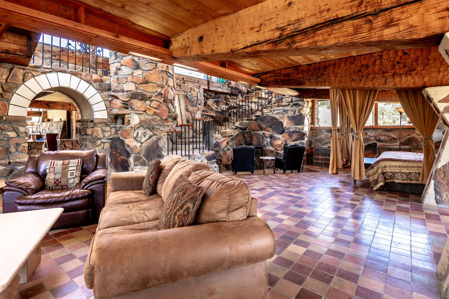 Mid Century Masterpiece created by an accomplished very well known architect who's connection to the Mojave Desert inspired the robust home's need to abandon traditional building materials Utilizing all stone and cement walls and Old Growth Beams