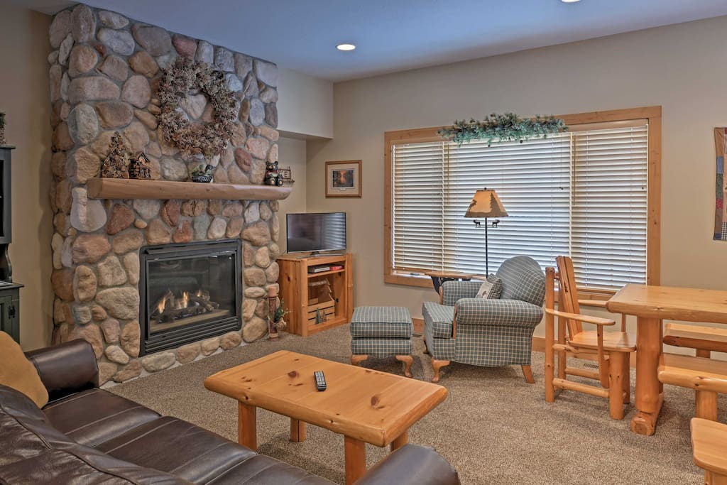 This cozy interior hosts up to 6 guests for an unforgettable Gull Lake retreat.