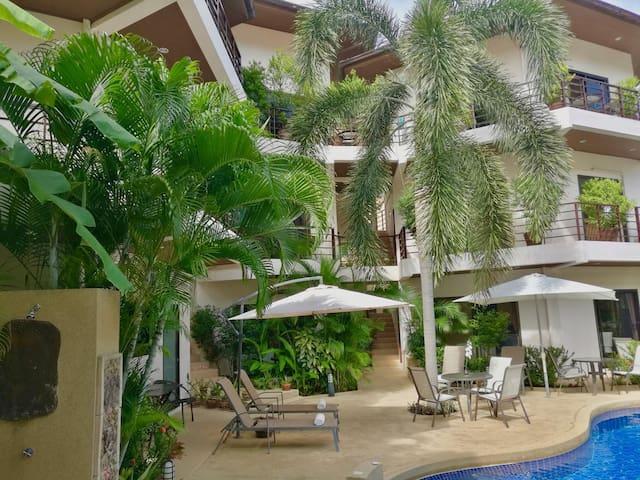 1-Bedroom Apt- balcony overlooking pool near beach