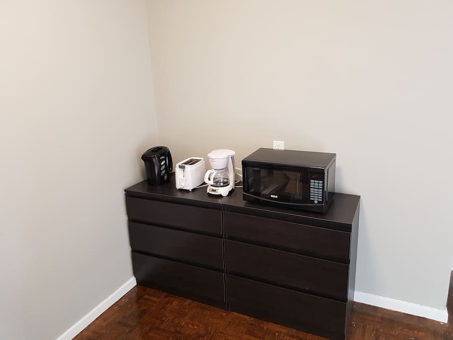 Coffee maker, toaster, kettle, and microwave are all included. Free coffee and tea as well.