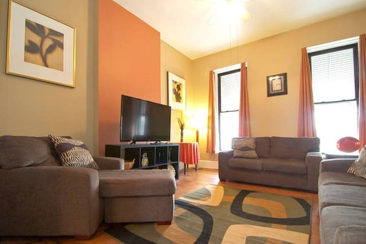 "55"" HDTV with cable. Relax after enjoying everything that the great city of Chicago has to offer. (Downstairs)"