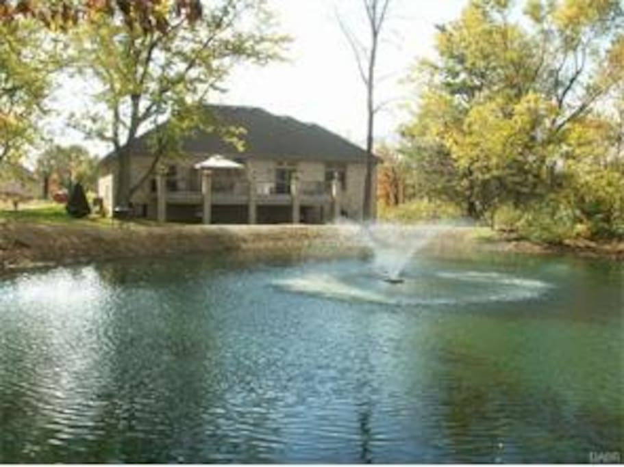 Home sits on 2 acre Private Wooded Lot with a Pond