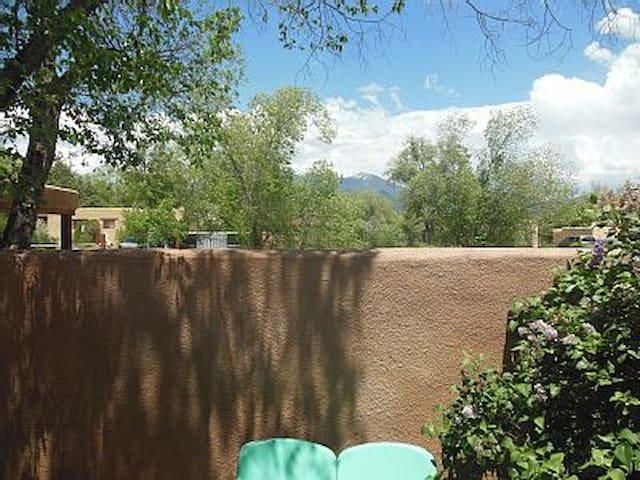 Walled courtyard with mountain view