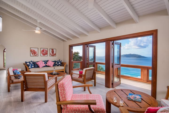 Beautifully appointed living area with ample seating and doors opening onto a balcony.  Enjoy the ocean breezes and view of the surf.