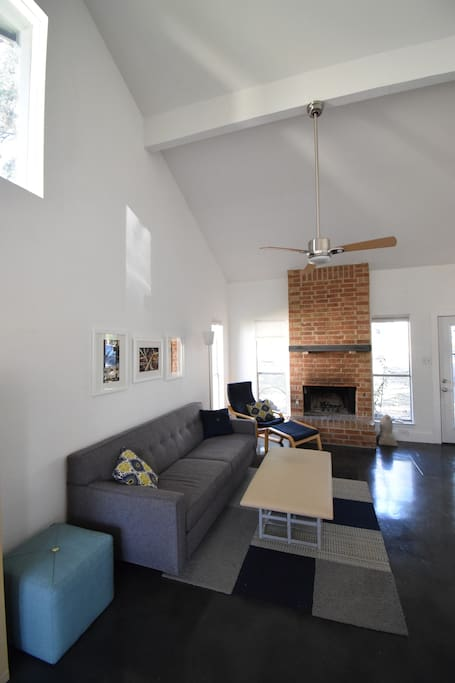 Vaulted ceilings and a working wood fireplace.
