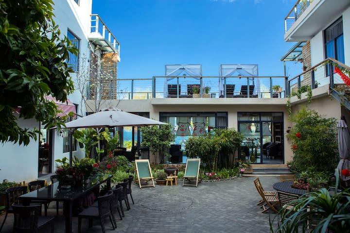 洱海边的家·恬舍酒店豪华海景双床房 - Dali - Boutique-hotell