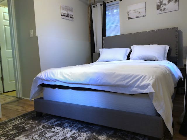 Queen bed with a memory foam mattress and cozy linens