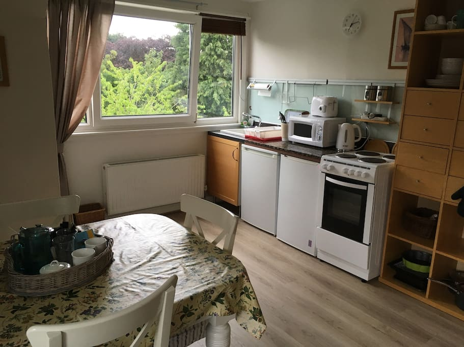 A fully equipped kitchen with fridge, freezer, microwave, four ring electric cooker and electric kettle. All pots, pans, cutlery etc. Cook a quick snack or romantic supper for two.